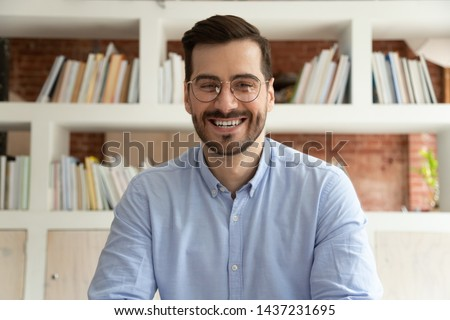Happy male coach teacher webinar speaker looking at camera giving online class lecture or making conference video chat call, smiling businessman entrepreneur recording video training, webcam view