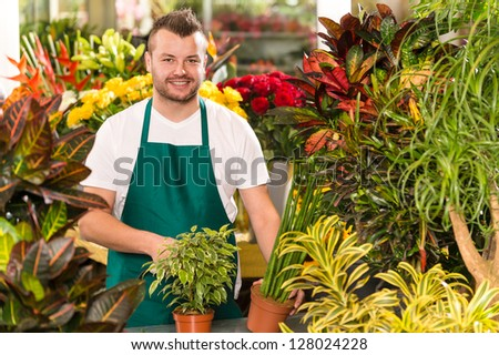 Happy male florist working flower gardening shop market assistant