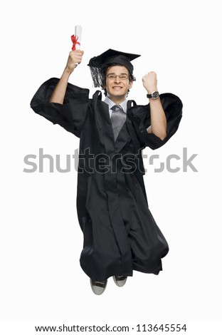 Happy male graduate holding his diploma and jumping