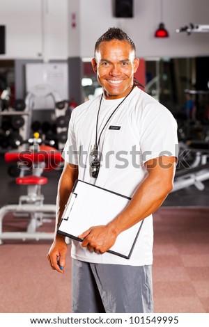 happy male gym instructor portrait