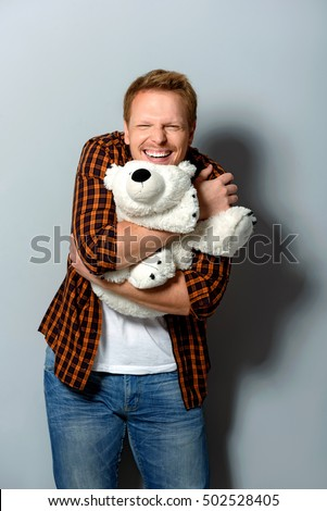 happy male hugging a toy #502528405