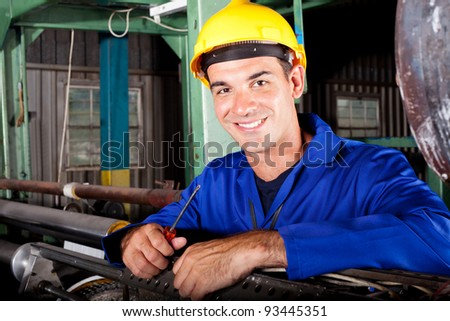 happy male industrial mechanic at work