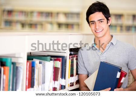 Shutterstock Happy male student holding books at the library