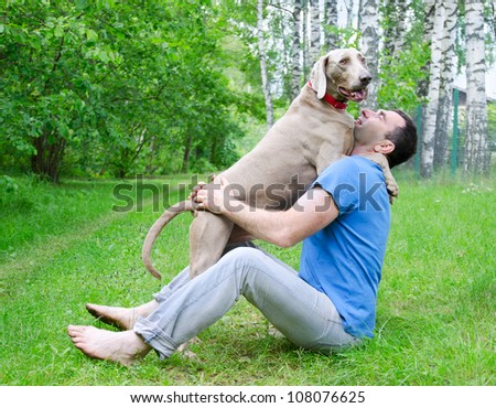Happy man and his dog in summer