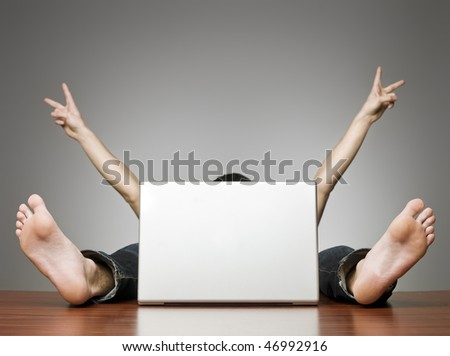 Happy man behind computer in an office