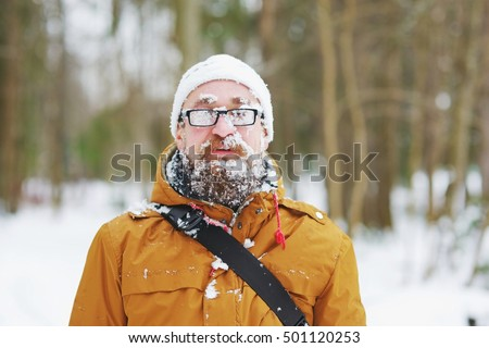happy man covered by snow...