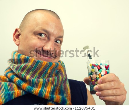 Happy man drinking cocktail of colorful pills