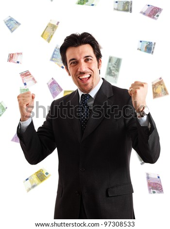 Happy man enjoying a rain of money - stock photo