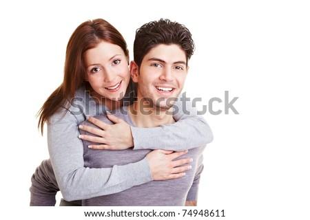 Happy man giving his girlfriend a piggyback ride