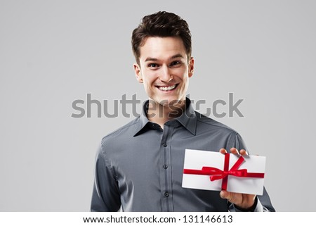 Happy man holding white card