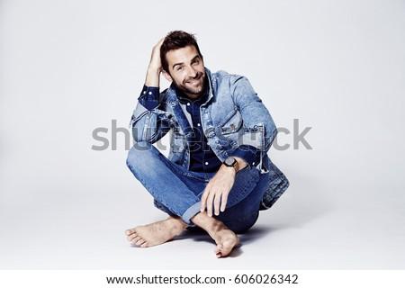 Happy man in blue denim fashion, portrait