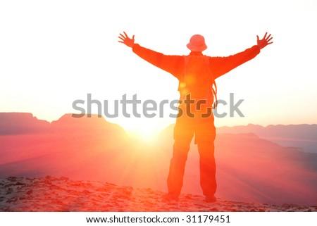 Happy man on sunrise