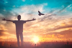 Happy man rise hand on morning view. Christian inspire praise God on good friday background. Male self confidence empowerment on mission arm courage nature the sun concept strength wisdom