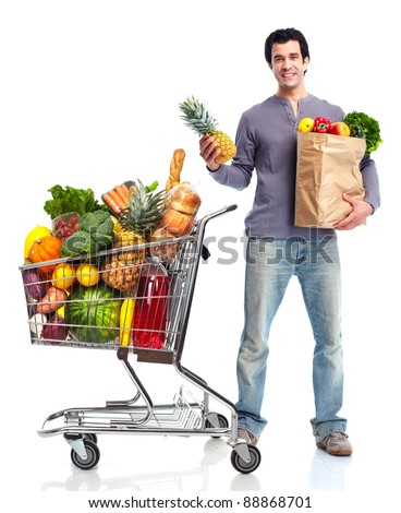 Happy man shopping in supermarket grocery . Isolated over white background.