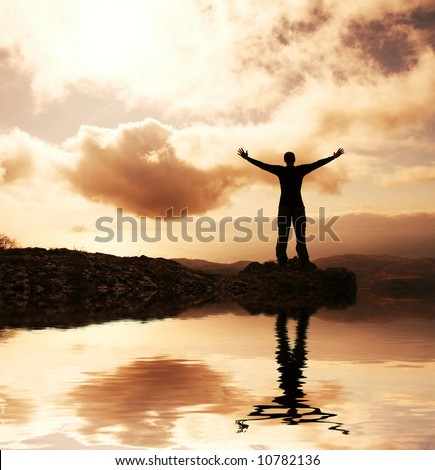 Happy man silhouette on the sunny sky - stock photo