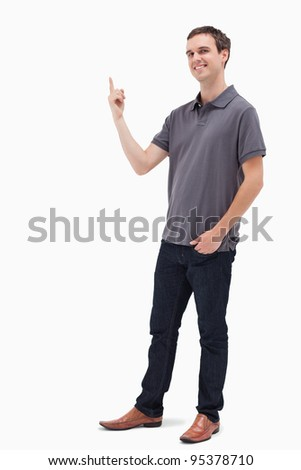 Happy man standing and presenting something above against white background