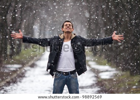 happy man staying under the snow