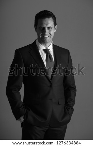 03440760b Happy man, successful businessman or confident boss smiling with hands in  pockets in blue fashionable