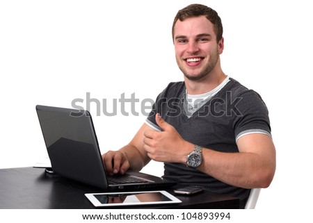 Happy man using pc and smiling while doing thumb up