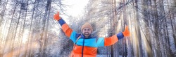 happy man winter forest waving hand gesture, winter view, extreme sport tourism