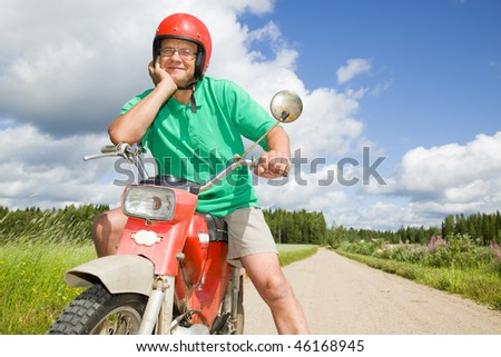 Happy man with his moped