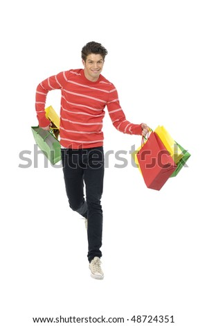 Happy man with shopping bag run