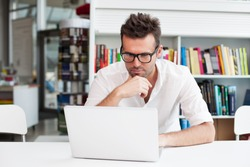 Happy man working on laptop