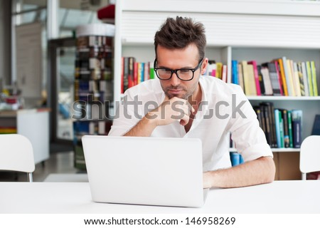 Happy man working on laptop