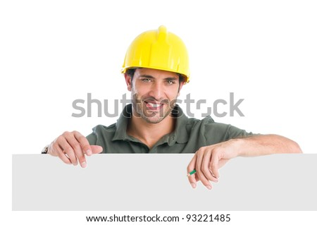 Happy manual worker presenting your text isolated on white background