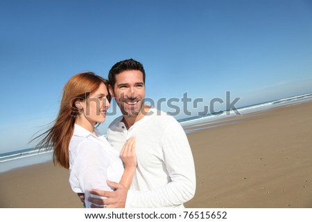 Happy married couple at the beach