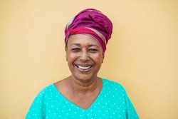 Happy mature african woman looking at camera - Focus on face
