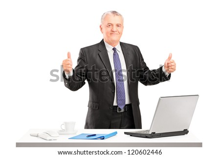 Happy mature businessman standing and giving thumbs up isolated on white background