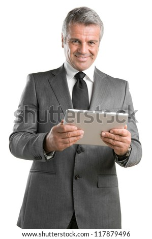 Happy mature businessman working with modern tablet isolated on white background - stock photo