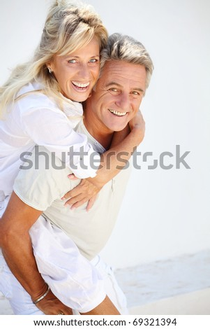 stock photo happy mature couple having fun 69321394 Review: 'Young Adult' offers cruelly mature fun