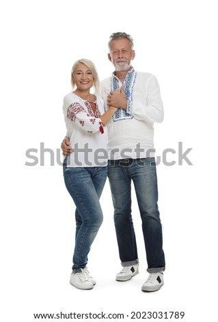 Happy mature couple in Ukrainian national clothes on white background Сток-фото ©