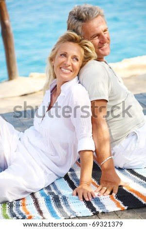 Happy mature couple outdoors.