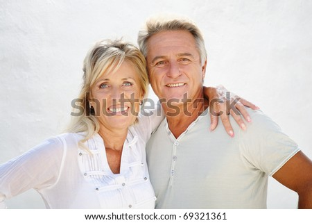 Happy mature couple smiling and embracing.