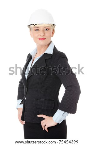 Happy mature engineer woman. Isolated on white background.