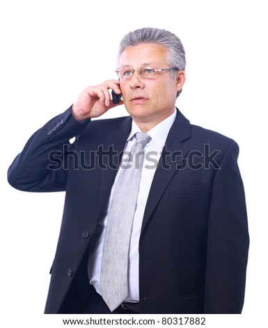 stock photo happy mature executive talking on mobile phone isolated on white background 80317882 stock photo : Indian mature business man with mobile phone