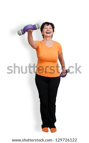Happy mature fitness woman exercising with barbells - isolated on white