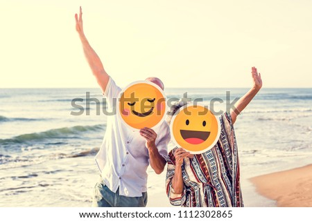 Happy mature mother and son at the beach