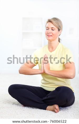 Happy mature woman doing yoga. Healthy life.