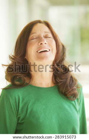 Happy mature woman laughing