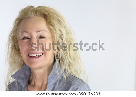 Happy mature woman with great smile #390176233