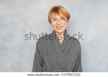 Happy mature woman with short haircut portrait