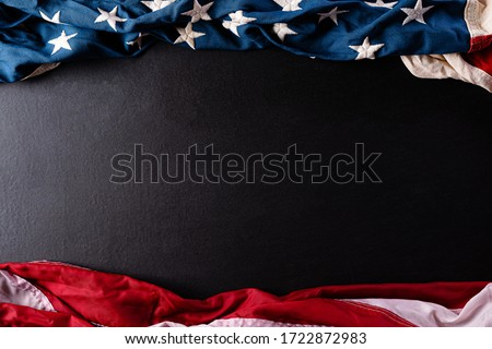 Happy Memorial Day. American flags with the text REMEMBER & HONOR against a black  background. May 25.