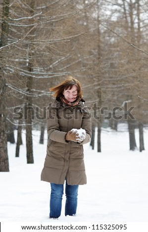 Happy middle age woman having fun in winter