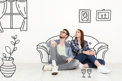 Happy millennial couple imagining interior of their new home, collage with sketch drawings on white wall