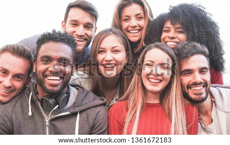 Happy millennial friends from diverse cultures and races taking selfie for social network story - Youth and friendship concept with young people having fun together - Main focus on black man face