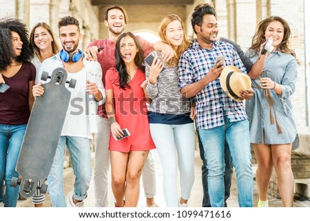 Happy millennials friends having fun together - Young people walking and laughing together in old town street- Youth lifestyle, generation z and friendship concept - Main focus on center guys
